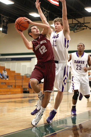 Round Rock's Larry Sparks takes a shot against Midland at the McNeil Classic on Thursday.