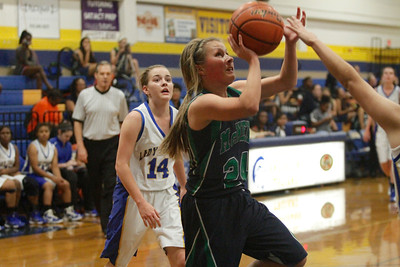 Scarlett Smith drives to the hoop against Austin Anderson Tuesday at Anderson High School.