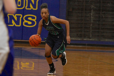 Troi Swain dribbles the ball up court against Austin Anderson Tuesday at Anderson High School.