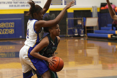 Tori Swain fights for space against Austin Anderson Tuesday at Anderson High School.