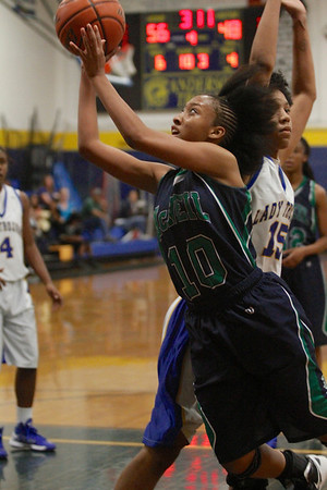 Troi Swain drives towards the basket against Austin Anderson Tuesday at Anderson High  School.