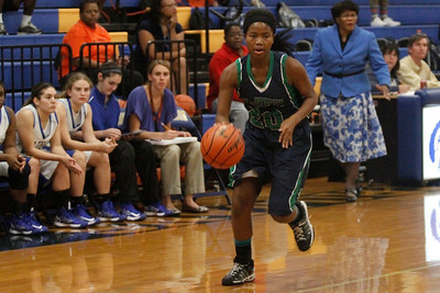 Ruth Egbuson dribbles the ball up court against Austin Anderson Tuesday at Anderson High School.