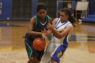 Ruth Egbuson battles with an Anderson defender against Austin Anderson Tuesday at Anderson High School.