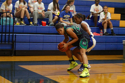 Karissa Black turns away from a defender against Austin Anderson Tuesday at Anderson High School.