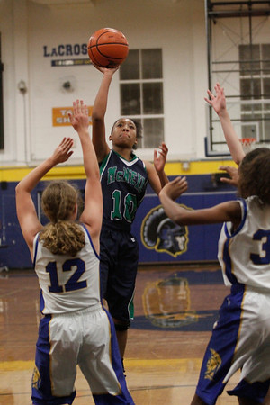 Troi Swain attempts a shot against Austin Anderson Tuesday at Anderson High  School.