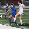 Katie Spence of Avon kicks the ball away from Caylee Jozefov of Brunswick during he first half. Randy Meyers -- The Morning Journal