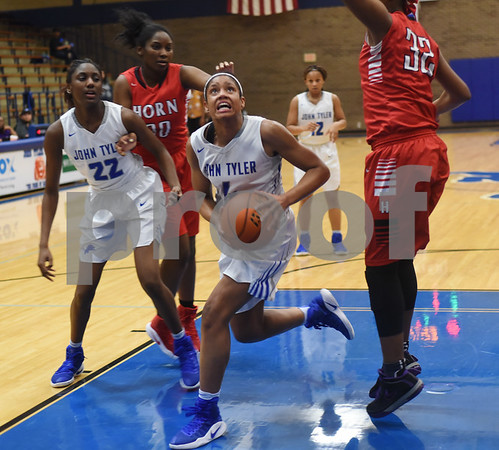 John Tyler's Alyssa Mayfield eyes the basket as the Lady Lions play Mesquite Horn at home Tuesday Jan. 10, 2017.  (Sarah A. Miller/Tyler Morning Telegraph)
