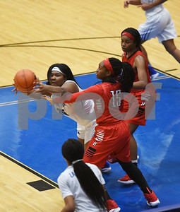John Tyler's Bri Criss reaches for the rebound as Mesquite Horn's Tajuan Lewis reaches to stop her during the Lady Lions' game at home Tuesday Jan. 10, 2017.  (Sarah A. Miller/Tyler Morning Telegraph)