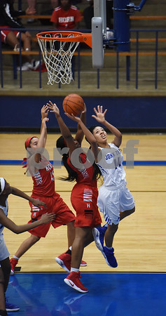 John Tyler's Jaz Hicks shoots for a basket as the Lady Lions play Mesquite Horn at home Tuesday Jan. 10, 2017.  (Sarah A. Miller/Tyler Morning Telegraph)