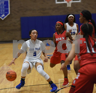 John Tyler's Destini Whitehead dribbles the ball as the Lady Lions play Mesquite Horn at home Tuesday Jan. 10, 2017.  (Sarah A. Miller/Tyler Morning Telegraph)
