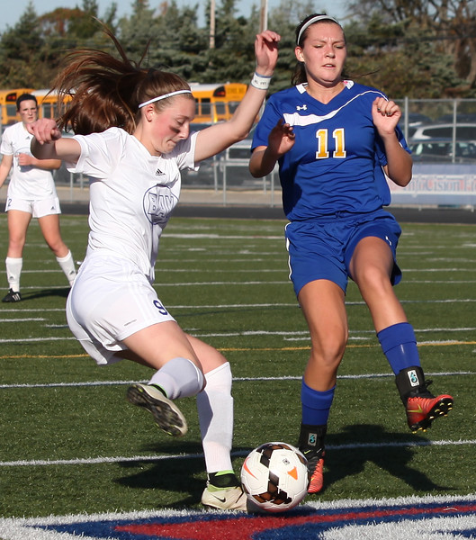 Bay's Alex Hoffman kicks past Faith Nigh of Ontario and toward the goal during the first half of a regional final. Randy Meyers -- The Morning Journal