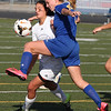 Kait Schuster of Ontario and Bay's Megan Garrity collide near the goal.  Randy Meyers -- The Morning Journal