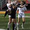 Bay's Megan Garrity and Ally Ducas of Chagrin Falls collide near the sideline. Randy Meyers -- The Morning Journal
