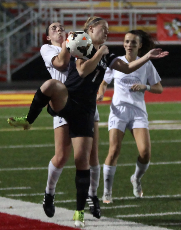 . Bay\'s Megan Garrity and Ally Ducas of Chagrin Falls collide near the sideline. Randy Meyers -- The Morning Journal