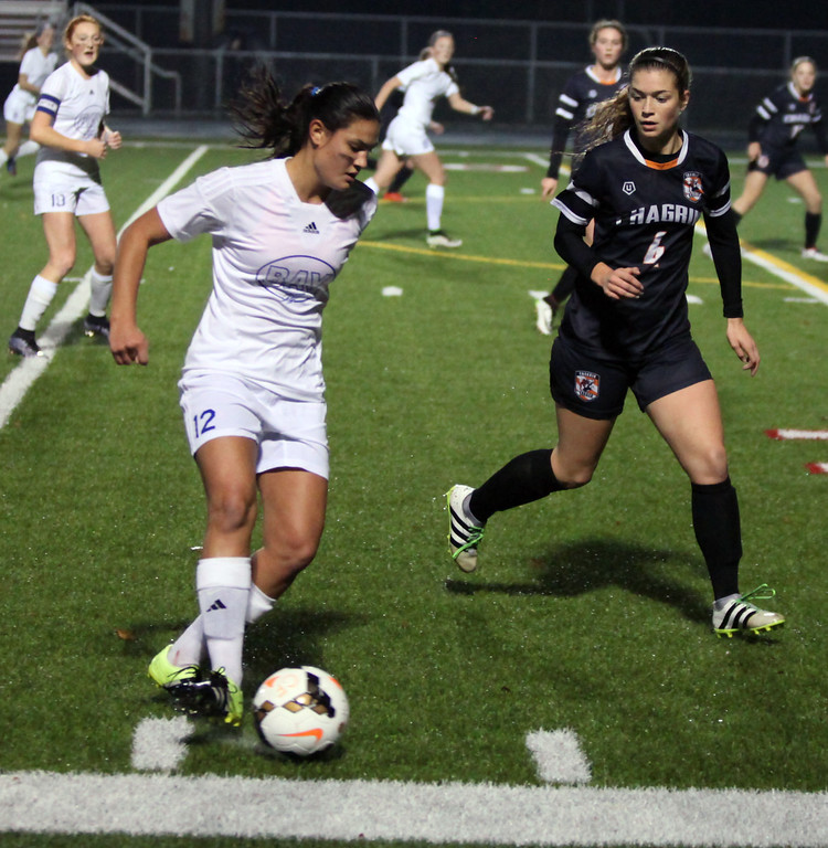 . Bay\'s Autumn Meiserburg moves the ball near the sideline and past Keely Malone of Chagrin Falls. Randy Meyers -- The Morning Journal