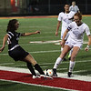 Bay Maddie Holmes and Chagrin Falls' Kelsey Taussig battle for possession of the ball. Randy Meyers -- The Morning Journal