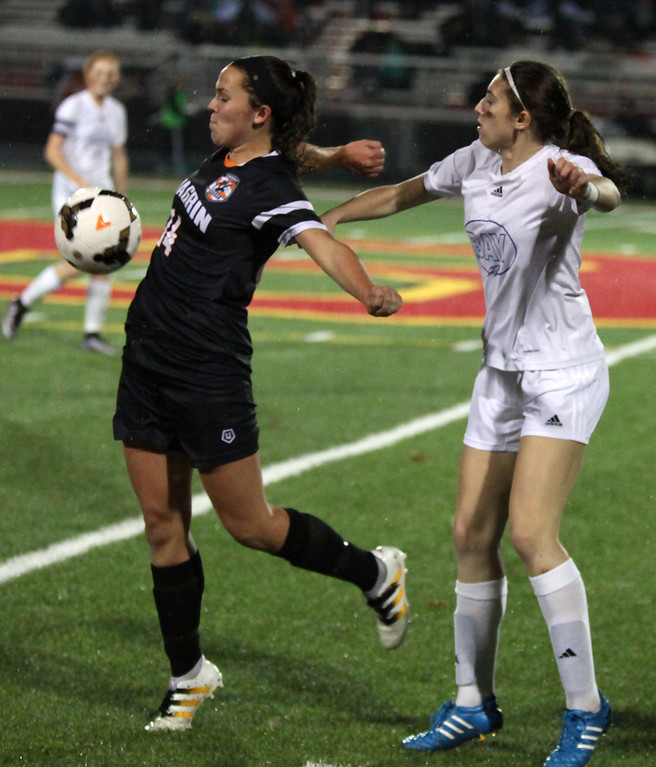 . Maddie Miralia of Chagrin Falls takes the ball off of her body on an inbounds toss and in front of Bay\'s Avery Alexy. Randy Meyers -- The Morning Journal