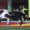 Chagrin Falls' Katie Schumacher kicks the ball away from her goal as Bay's Alex Hoffman closes in. Randy Meyers -- The Morning Journal