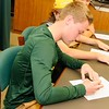 Elyria Catholic's Brandon Netzel signs a letter of intent to play golf at Tiffin University at a National Signing Day event atthe school on Nov. 9. Courtesy Allen Clark