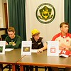 Elyria Catholic athletes, from left, Brandon Netzel, Tony LoParo, and Andrew Abrahamowicz sign letters of intent at a National Signing Day event at the school. Courtesy Allen Clark