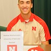 Elyria Catholic's Andrew Abrahamowicz signs a letter of intent to play baseball at the University of Nebraska at a National Signing Day event at the school on Nov. 9. Courtesy Allen Clark, Elyria Catholic High School Andrew Abrahamowicz signs a letter of intent to play baseball at the University of Nebraska at a National Signing Day event at Elyria Catholic High School on Nov. 9.