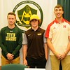Elyria Catholic athletes, from left,  Brandon Netzel, Tony LoParo, and Andrew Abrahamowicz pose after signing letters of intent at a National Signing Day event at the school on Nov. 9. Courtesy Allen Clark