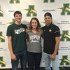 From left, Brian D'Andrea, Sydney Roule, and Xavier Moore pose at Amherst Steele High School following a National Signing Day event. Marissa McNees -- The Morning Journa