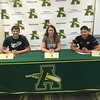 From left, Brian D'Andrea, Sydney Roule, and Xavier Moore sign their letters of intent at a National Signing Day event at Amherst Steele High School. Marissa McNees -- The Morning Journal
