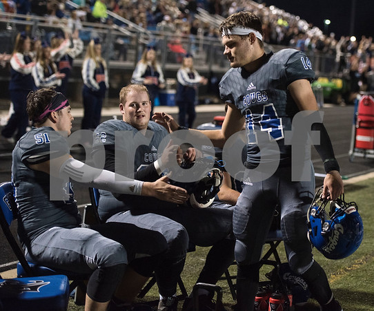 Grace Community School's Braydon Stone high-fives teammate (51) Garrison Starr as he returns to the bench after scoring a touchdown against The Brook Hill School Friday Nov. 10, 2017.  (Sarah A. Miller/Tyler Morning Telegraph)