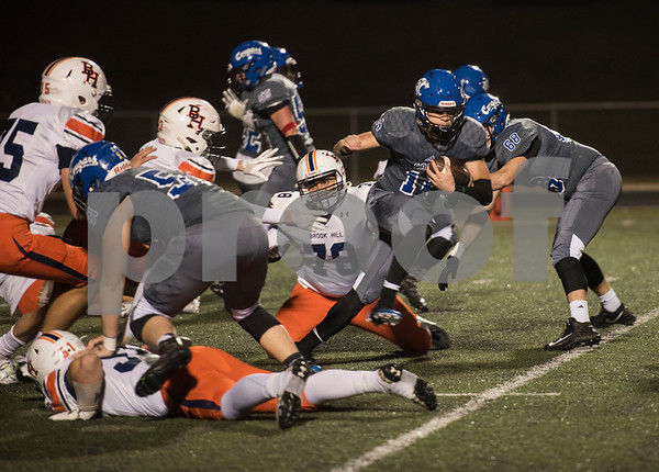 Grace Community School's Braydon Stone breaks away from Brook Hill defenders during the Grace Community School football game at home against The Brook Hill School Friday Nov. 10, 2017.  (Sarah A. Miller/Tyler Morning Telegraph)