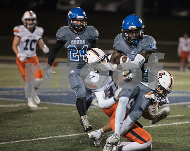Grace Community School's Uchenna Uduma (22) is tackled by Brook Hill's (17) Jake Shaffer and (34) John Dixon during the Grace Community School football game at home against The Brook Hill School Friday Nov. 10, 2017.  (Sarah A. Miller/Tyler Morning Telegraph)