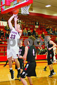 Photo by Shannon Wilson / Tyler Morning Telegraph Robert E. Lee's Caleb Johnston (33) shoots and scores during Friday night's game against Rockwall-Heath.