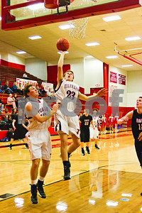 Photo by Shannon Wilson / Tyler Morning Telegraph Robert E. Lee's Taylor Tankepsley (23) shoots on the rebound and scores during Friday night's game against Rockwall-Heath.