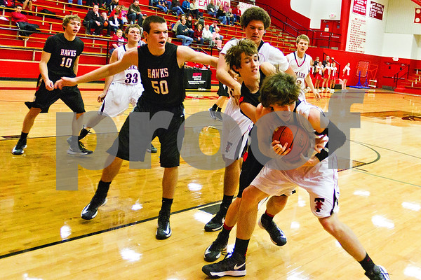 Photo by Shannon Wilson / Tyler Morning Telegraph Red Raider Tucker Boyd (34) gets the ball on a rebound in Friday night's game against Rockwall-Heath.