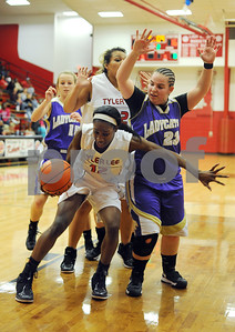 photo by Sarah A. Miller/Tyler Morning Telegraph  Robert E. Lee's (12) Dajah Thompson dribbles around Hallsville's (23) Abby Reeder during their game Tuesday night in Tyler.