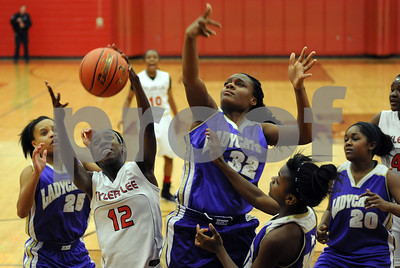 photo by Sarah A. Miller/Tyler Morning Telegraph  Robert E. Lee's (12) Dajah Thompson gains control of the ball near the basket during their game Tuesday night against Hallsville in Tyler.