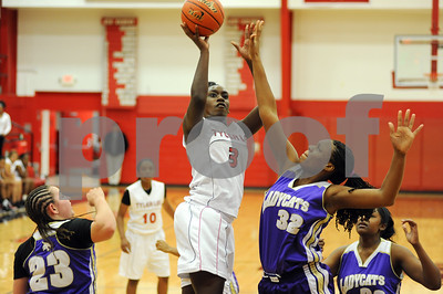 photo by Sarah A. Miller/Tyler Morning Telegraph  Robert E. Lee's (3) Ciara Johnson shoots for the basket past Hallsville's (32) Dominque Templeton during their game Tuesday night in Tyler.