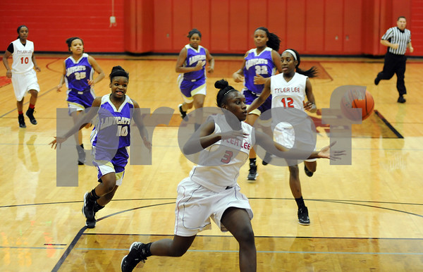 photo by Sarah A. Miller/Tyler Morning Telegraph  Robert E. Lee's (3) Ciara Johnson gains control of the ball during their game Tuesday night against Hallsville in Tyler.