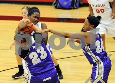 photo by Sarah A. Miller/Tyler Morning Telegraph  Robert E. Lee's (40) Emem David struggles with Hallsville's (23) Abby Reeder for control of the ball during their game Tuesday night in Tyler.