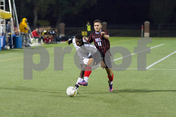 TJC's Mohammed Kamara battles for the ball against Hill College's Mostafa Kamal in game 4 of pool play in the NJCAA Mens National Soccer Tourament being played at Pat Hartley Field in Tyler TX.  Photo by John Murphy