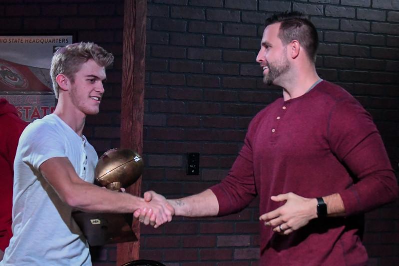 Matt Wilhelm presents Avon quarterback Ryan Maloy with the Matt Wilhelm Award during Varsity Chalk Talk at the Hooley House, Nov. 14, 2017. Eric Bonzar — The Morning Journal