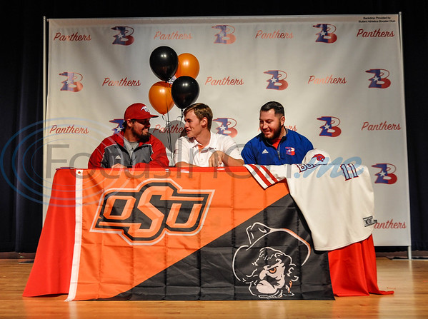 Bullard High School senior Colton Bowman (center) is joined on stage by Bullard baseball coaches Brock Lemire (left) and Caleb Gibson (right) as he signs his intent to attend Oklahoma State University on Wednesday, November 14. Bowman will attend the University on a full baseball scholarship next fall. (Jessica T. Payne/Tyler Morning Telegraph)