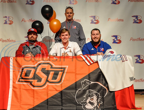 Bullard High School baseball player Colton Bowman is all smiles at his signing to Oklahoma State University.  Bowman (center) was joined on stage by Bullard baseball coaches Brock Lemire (left), Caleb Gibson (right) and Athletic Director Scott Callaway (back) at the signing which took place at Bullard High School on Wednesday, November 14. (Jessica T. Payne/Tyler Morning Telegraph)