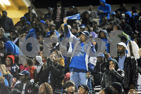 photo by Sarah A. Miller/Tyler Morning Telegraph  A John Tyler fan waves a towel in celebration of a touchdown during the Class 4A Division I bi-district playoff game at Homer B. Johnson Stadium in Garland Friday night.