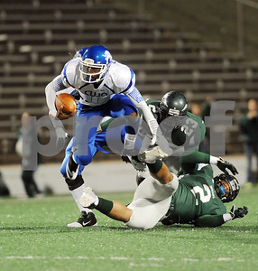photo by Sarah A. Miller/Tyler Morning Telegraph  John Tyler's (1) senior Greg Ward jumps out of the way of Waxahachie players during the Class 4A Division I bi-district playoff game at Homer B. Johnson Stadium in Garland Friday night.