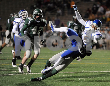 photo by Sarah A. Miller/Tyler Morning Telegraph  Waxahachie's (7) senior Andre Green picks up and body slams John Tyler's (2) senior Darion Flowers during the Class 4A Division I bi-district playoff game at Homer B. Johnson Stadium in Garland Friday night.