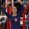 Avon's Domenica Marino sets the ball during the East vs West match. Randy Meyers -- The Morning Journal