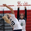 Elyria Catholic's Jasmine Hromada defends the spike by Raegan Osko of Lorain during the All-Stars North vs South match. Randy Meyers -- The Morning Journal