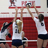 Lorain's Sarah Leighliter and Raegan Osko defend the spike by Jasmine Hromada of Elyria Catholic during the North vs South match. Randy Meyers -- The Morning Journal