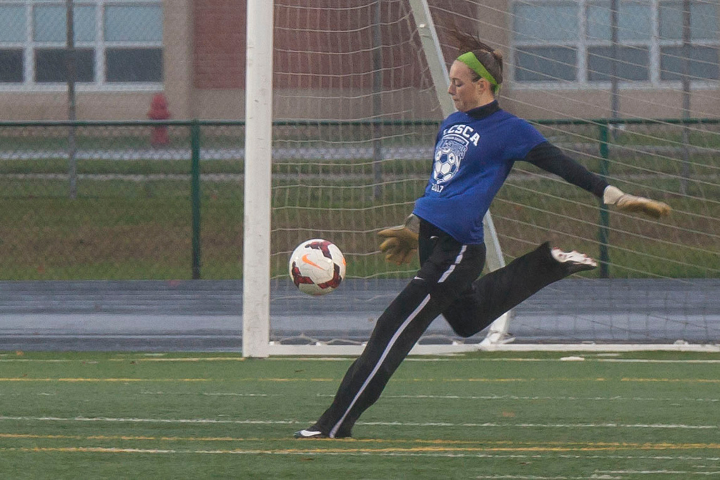. Avon\'s Maggie Beatty punts the ball from her position as goalkeeper. Jen Forbus -- The Morning Journal